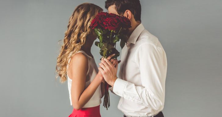 Couple behind flowers